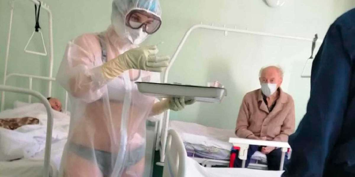 Female nurse pictured wearing 'lingerie' under PPE gown in Russian hospital